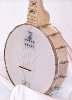 A great banjo for clawhammer and old-time playing. A rock maple neck and 3ply maple laminate pot make for a very attractive and great sounding instrument. The the 16 head brackets and steel coordinator rod inside the pot help to keep the instrument balanced at the right tension. Comes with a fitted, Deering soft-shell case. Electric models come with a Kavanjo Banjo Pickup. This patented system involves a suspended magnetic pickup that is secured to the head of the banjo, just under the strin...