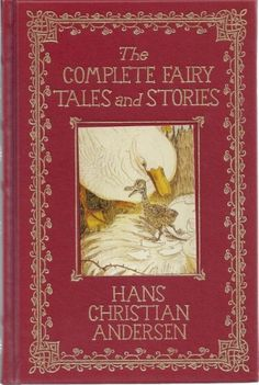 """I have a 1975 """"Facsimile of the 1884 Edition,"""" yellowed with age and a bit stained from many readings. One of my cherished possessions. Not fancy like this, just plain red and embossed with gold, reading """"Fairy Tales by Hans Christian Andersen"""""""