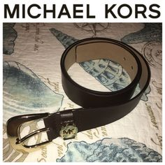 """Michael Kors Brown Belt Good condition, worn a few times! Dark brown, genuine leather Michael Kors belt with gold hardware and """"MK"""" logo on the buckle. There are a few very minor signs of wear on the inside of the belt near the buckle holes (pictured), otherwise in excellent condition! Michael Kors Accessories Belts"""