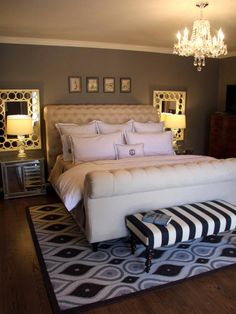 I like the headboard of this bed and the chandelier. Gives the room an elegant and classy feel yet very cozy.