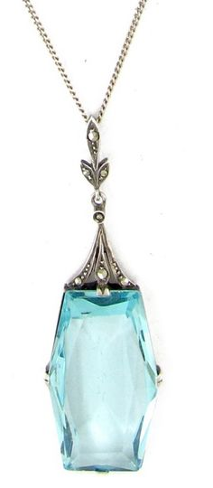 Art Deco Silver & Blue Paste Pendant on Silver Chain Art Deco (1920-1935)Item No. 530E An Art Deco pendant which is composed of a large blue faceted paste to imitate aquamarine and marcasite to imitate diamonds. It is silver and was made circa 1925. It is a fantastic looking piece.