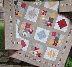 Hometown Love.  quilt stats: 78 inches square 25 blocks, measuring 10 3/4 inch each.  Including a 1 3/4 inch strip around each block of Kona Stone. 1 3/4 inch square scrappy border.
