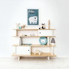 Gorgeous shelf styling proving less is more from @bobbyrabbitkids  #shelfie #playroom #kidsroom #nurseryinspo