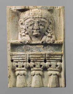 "Ivory, inlaid w/glass, Plaque with ""woman at the window"" motif, ca 9th–8th c. BC; Neo-Assyrian period; Phoenician style. Probably Arslan Tash, Syria"