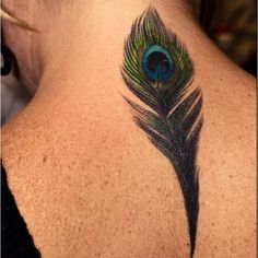 Peacock feather tattoo! Cute.