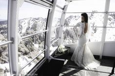 Squaw Valley Lake Tahoe Winter Wedding with the Bride Wearing a Long Sleeve Laced Gown.