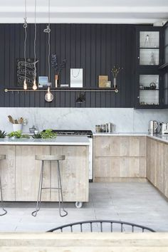 An industrial kitchen with exposed light bulbs