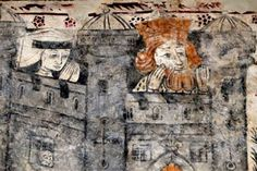 """Medieval wall painting showing a castle """"from where the ginger- bearded king and his distraught queen are watching from the battlements. There's even someone looking out of a window, that's very unusual, no-one expected that at all,"""" Mr Smith said.   They had lain hidden under 21 layers of limewash since the Reformation, 460 years ago, in St Cadoc's church in Llancarfan, Wales."""