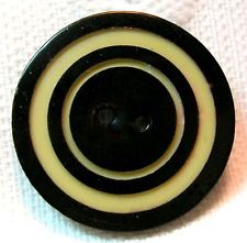 1920'S ART DECO COAL BLACK & IVORY TARGET CARVED CELLULOID WAFER BUTTON