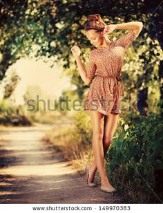 Beauty Romantic Girl Outdoor. Beautiful Teenage Model Dressed in Fashionable Short Dress Posing Outdoors in Sun Light. Full Length Portrait....