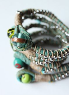 style-diaries: scrap bracelets - uses fabric only, no wire: just jute, bead chain and twisted fabric.