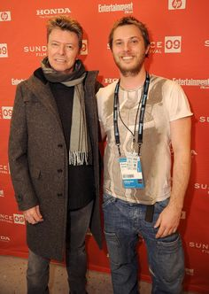 "David Bowie supports his son, director Duncan Jones (pictured right) at the premiere of his movie ""Moon"" during the 2009 Sundance Film Festival at Eccles Theatre on Jan. 23, 2009 in Park City, Utah. Bowie also left behind his daughter Alexandria ""Lexi"" Zahra Jones and wife supermodel Iman."