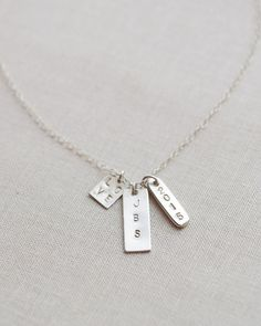 Personalized Tag Necklace by Olive Yew. Choose up to 3 petite sterling silver tags of various sizes to create your own special necklace.