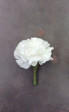 White carnation boutonniere with copper wire accents by Nancy at Belton Hyvee.