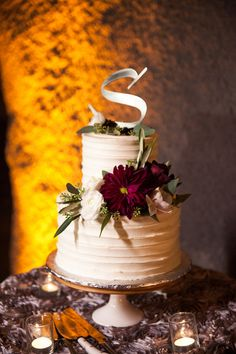 Modern two-tier cake idea - buttercream cake with fresh burgundy flowers and couple's monogram  {Nightingale Photography}