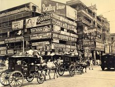 "Calcutta, ""A bewildering mass of billboards at the corner of Harrison Street (Burra Bazar) and Strand Road. One of the oldest sections of Calcutta, at the foot of Howrah Bridge. Rare Pictures, Rare Photos, Old Photos, Vintage Photos, Antique Photos, Vintage Photographs, Jaisalmer, Udaipur, Kolkata"