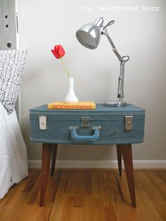 The Weathered Door: DIY Suitcase Side Table done for $11 using a suitcase and legs from a broken coffee table.
