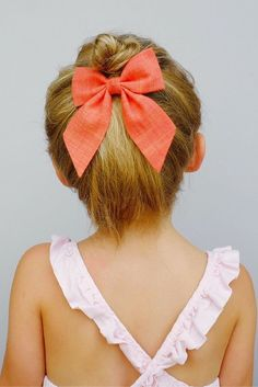 Classic chambray bow in vibrant coral attached to an alligator clip. Love this styled below a cute little top knot. // http://FreeBabesHandmade.com
