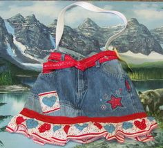 Hand crafted blue jean shirt with red and blue hearts and stars purse. $15.00
