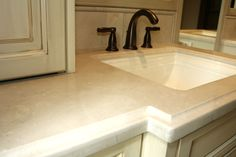 Like the beveled edge. The Granite Gurus: Slab Sunday: Crema Marfil marble Granite Colors, Dream Bathrooms, New Kitchen, Master Bathroom, Countertops, Interior Decorating, Sink, House Design, House Styles