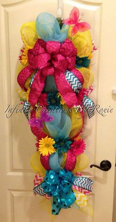 Spring Swag $120 Spring is right around the corner... Adorn your door with this beautiful swag  Visit @ www.facebook.com/InfiniteCreationsByRoxie