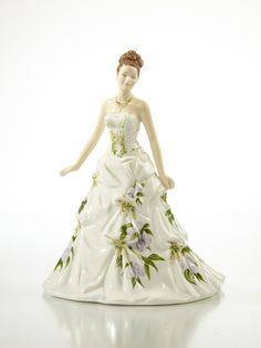 There's a story behind every English Ladies Co figurine and Jessica's is surely rather special. Romantic and charismatic Jessica is most certainly the belle of the ball in her beautiful gown with its gentle frills and bold floral design inspired by pretty wisteria flowers.