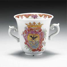 A DOCCIA PORCELAIN ARMORIAL CUP, CIRCA 1750