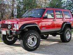 Red Jeep Cherokee With Lift Kit
