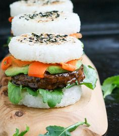 Try the latest food mash-up trend with these vegan sushi burgers! Teriyaki glazed bean patty avocado and pickled carrots between rice buns Sushi Recipes, Veggie Recipes, Whole Food Recipes, Vegetarian Recipes, Cooking Recipes, Recipies, Sushi Vegan, Vegan Foods, Vegan Dishes