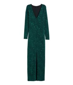 Fitted maxi dress in jersey with a printed pattern and glittery threads. V-neck, long sleeves, and high slit at front. Lined.