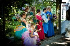 Flower fairies with different colored fairies.    From Aidan & John's Celtic renaissance faerie handfasting | Offbeat Bride