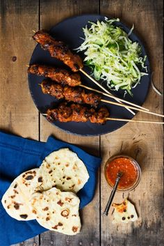 You'll be the life of the picnic with these hot skewers of marinated chicken and cabbage + cucumber slaw.