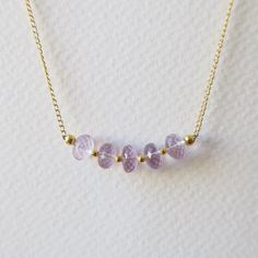 This chic gemstone necklace showcases gorgeous pink amethyst gemstones. Perfect for adding a feminine touch to your outfit. Handmade for Haelo Studio by Clair Summer.