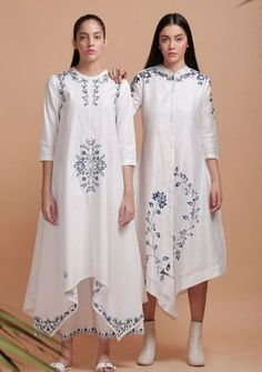 Beautiful Silk Asymetric Kurtis with grey embroidery. Great placement of embroidery create rich look. Beautiful Silk Asymetric Kurtis with grey embroidery. Great placement of embroidery create rich look. Tunic Designs, Kurti Neck Designs, Kurta Designs Women, Kurti Embroidery Design, Embroidery Fashion, Embroidery Dress, Embroidery Stitches, Women's Dresses, Fashion Dresses