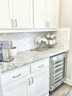 This Clic White Kitchen With Fresh Accents And Open Gl Louvered Cabinets Subway Tile Backsplash Is Timeless Love The