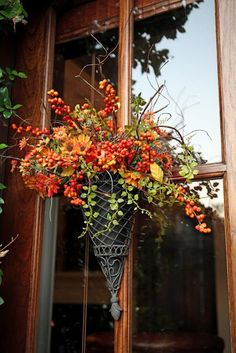 Something to do with my wall pocket just sitting in a box! Beautiful fall arrangement