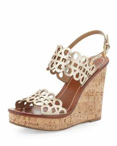 http://www.neimanmarcus.com/Tory-Burch-Nori-Laser-Cut-Wedge-Sandal-Platinum-Shoes/prod161990013_cat11670734__/p.prod?icid=&searchType=EndecaDrivenCat&rte=%252Fcategory.jsp%253FitemId%253Dcat11670734%2526pageSize%253D120%2526No%253D0%2526refinements%253D&eItemId=prod161990013&cmCat=product