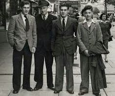 In 1940 there was more of heavily padded chests, enormous shoulders and wide flowing trousers seen in men.