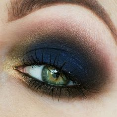This stunning smokey eye is defined by an intense deep blue eyeshadow color complimented with neutral shades. Try this eye makeup for irresistible night out eyes!