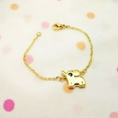 A personal favorite from my Etsy shop https://www.etsy.com/listing/194176183/gold-plated-cute-elephant-bracelettiny