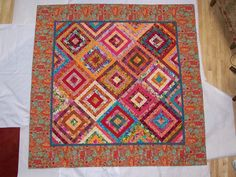 Kaffe Fassett Fabrics & Pattern in 2010. I called 'The Gypsy' donated, then auctioned off,  the Lincoln County Children's Advocacy Center  earned  $850.00.