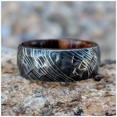 This gorgeous ring is made out of Damascus Steel.his damascus ring features a premium hammered finish as well as a inside Ironwood inside sleeve. Damascus Wedding Band, Damascus Ring, Damascus Steel, Unique Wedding Bands, Wedding Men, Wedding Rings, Lgbt Wedding, Wedding Bells, Wedding Stuff