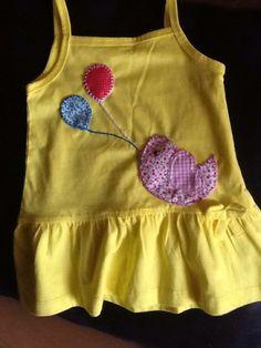 vestidinho de bébé com aplicações