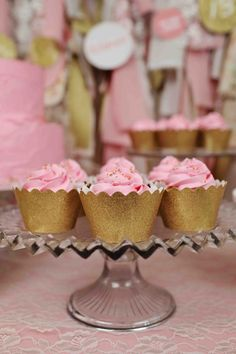 Glam Graduation Party Ideas - carrying the theme through in the desserts. Pink cupcakes with gold sparkly cupcake wrappers.