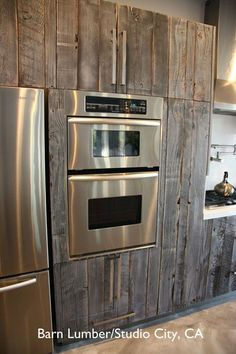 salvaged barn wood used to reface ikea cabinets, rustic, custom look. Oh I love this!