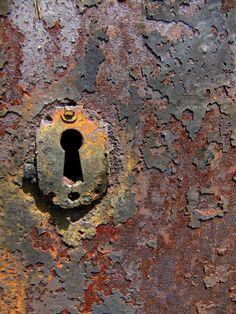 Rust sometimes DOES sleep  (Mausoleum door detail, Green Mount Cemetery, Baltimore, Maryland), 2010. Sherrie