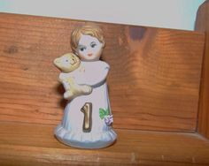 Baby girl first birthday keepsake. Enesco Growing Up 1, porcelain figurine. She is tiny, by oh so cute. She measures 2 1/2 inches high by 1 1/2
