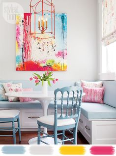 colorful artwork and light fixture