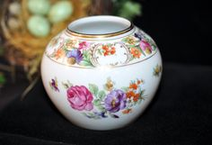 Outstanding Antique Dresden Flower Vase by Schumann This is a beautiful antique porcelain floral vase made in Germany. It is in very nice condition. This vase has beautiful flowers on all sides with pretty gold trim.... It matches so many Dresden floral patterns.... It would fun to put flowers in. This bowl would be a wonderful gift for someone who loves unusual antique Dresden prizes...... Please see our nice selection of Antiques: https://www.etsy.com/shop/souhernsister...
