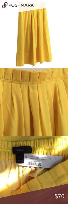 J.Crew Midi Skirt in Yellow Pull-on elastic skirt with paper-bag waist in bright lemon from J.Crew. NWT. Size 0. Lined with elastic waistband. Slit pockets. Midi length. Falls below knee. 100% polyester. J. Crew Skirts Midi
